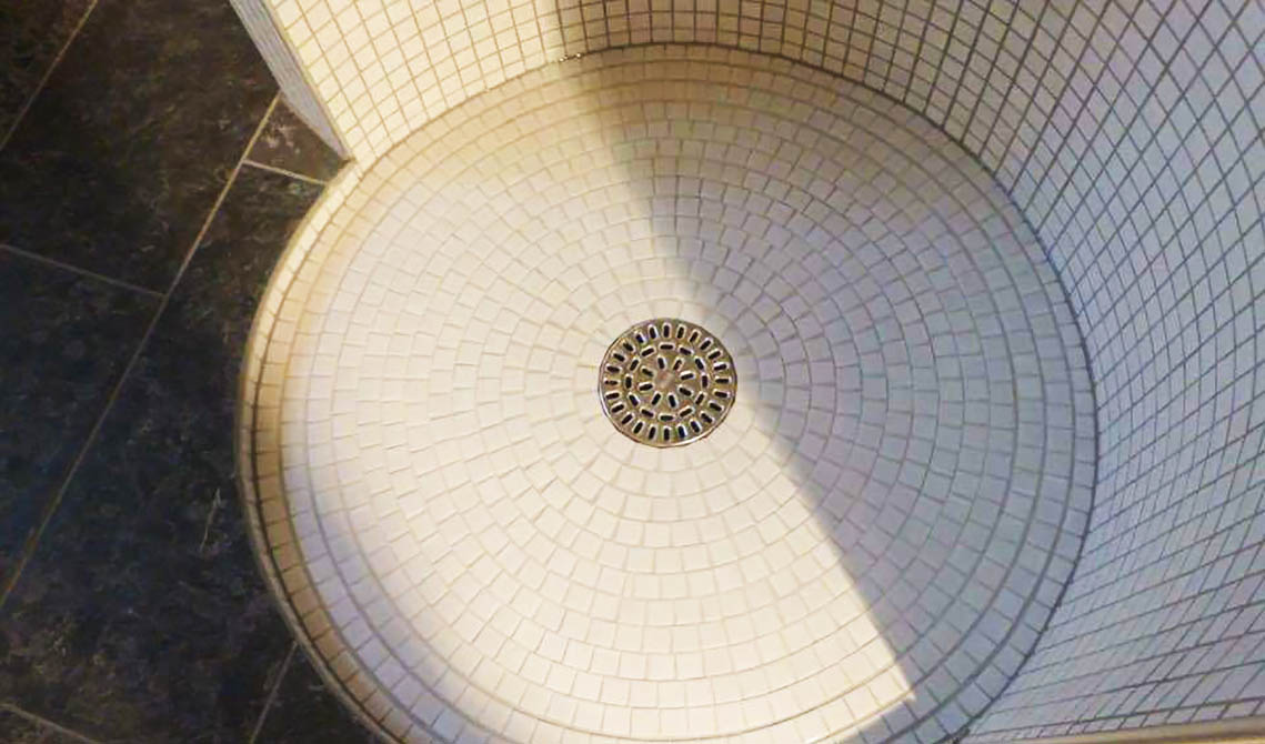 picture of bathroom after refurbishment shower mosaic tiling