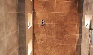 pictureof bathroom during fitting and tiling service by pb builder