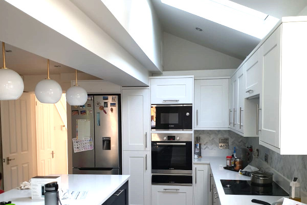 picture of kitchen after house extension construction services by pb builder sutton