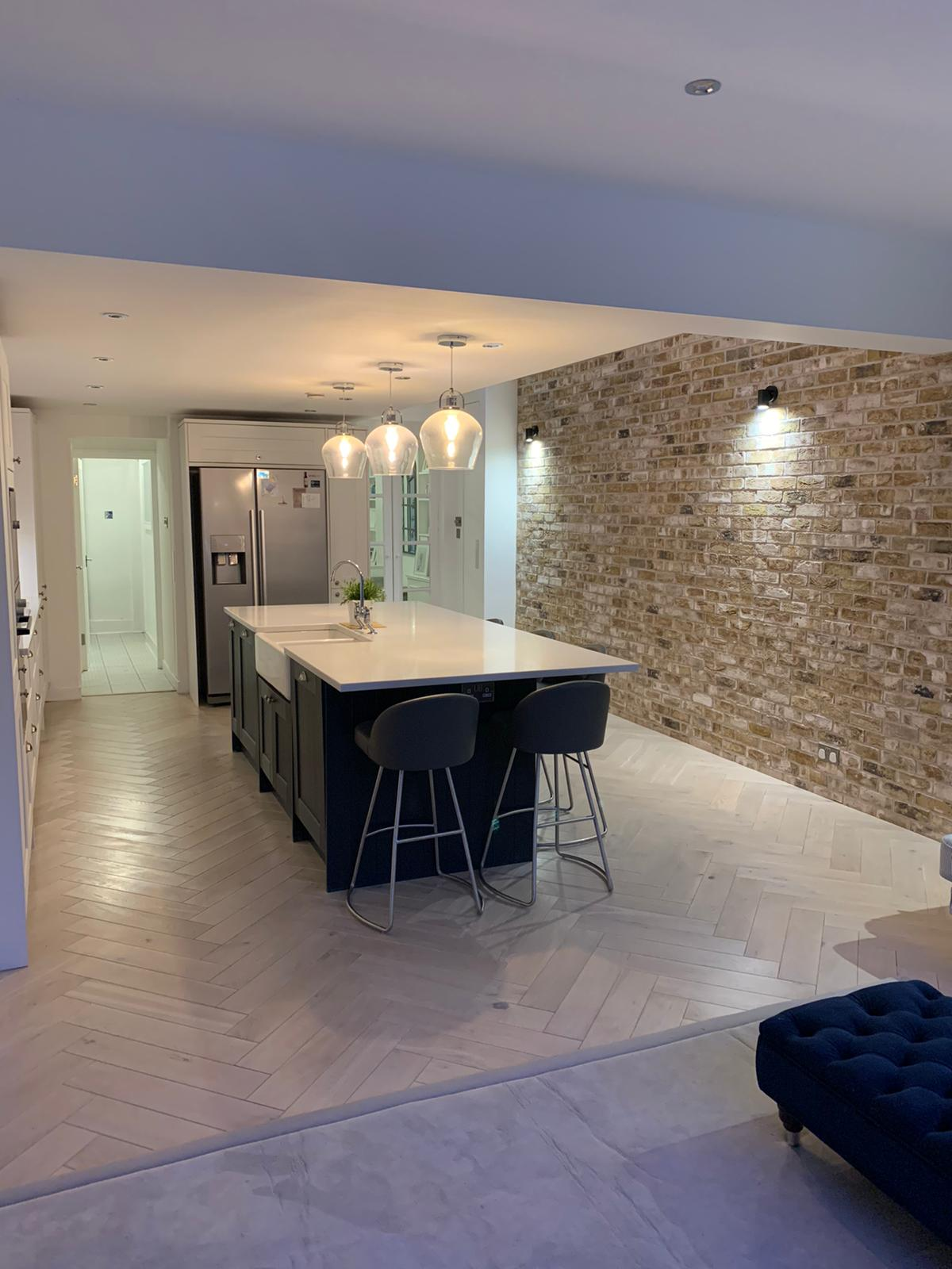 picture of side and rear house extension kitchen with brickwork imitation completed by PB Builder