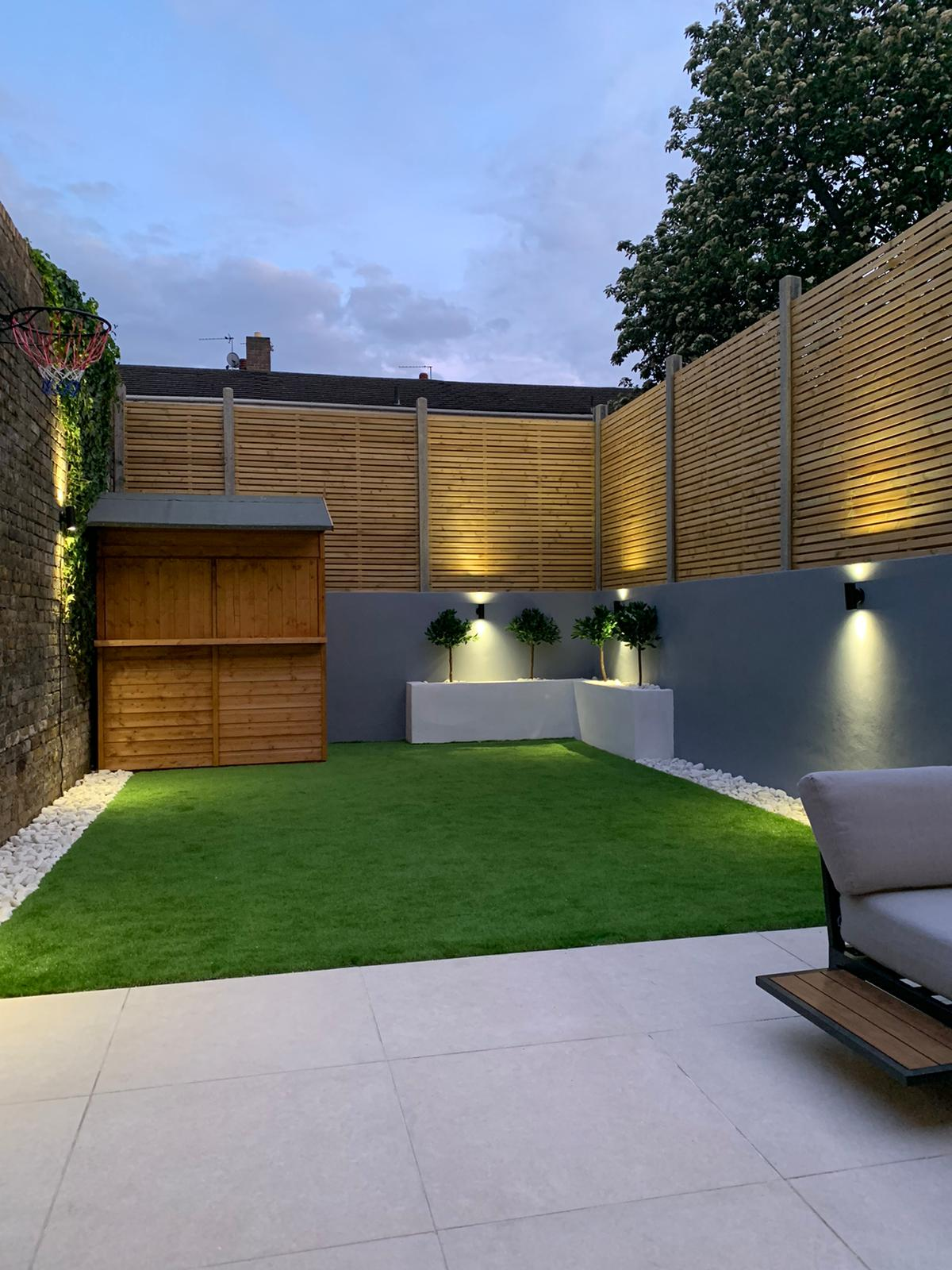 picture of backyard house extension at dusk with lights on