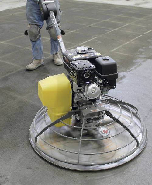 picture of man during smoothing concrete screed