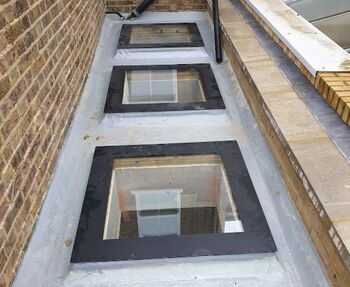 picture of three skylights installed in loft by pb builder
